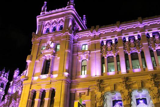 Beautiful City Hall of Madrid illuminated in purple in the International Women's Day