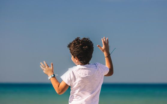 Happy Little Boy Having Fun on the Beach. Nice Child with Pleasure Spending Holidays in Summer Camp on Seashore. Happy Carefree Childhood.
