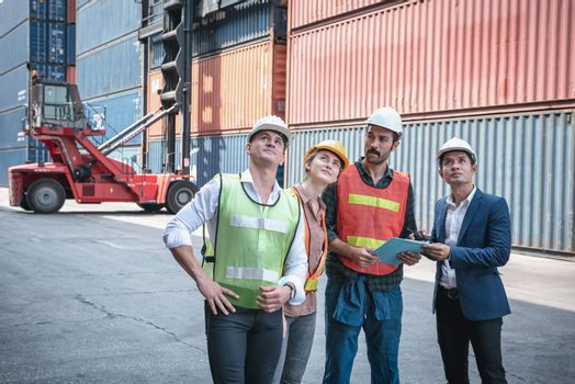 Container Shipping Logistics Engineering of Import/Export Transportation Industry, Transport Engineers Group Teamwork Controlling Management Containers Box at Port Ship Loading Dock. Business Team