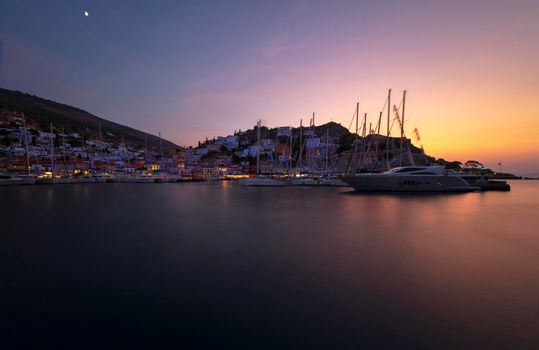 Beautiful Landscape of a Peaceful Harbor for a Sail Boats in Mild Sunset Light. Luxury Sea Cruise. Summer Holidays in Greece.